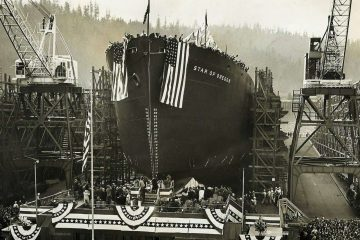 S.S. Star of Oregon Inauguration with the boy draped in US flags and bunting